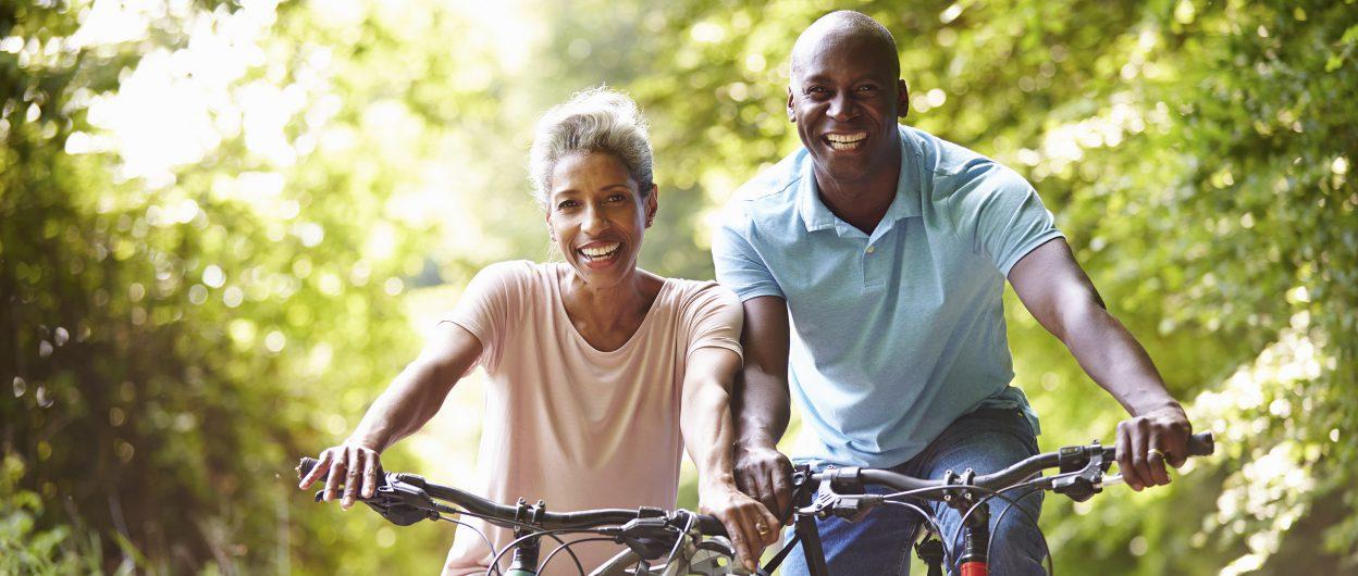 Couple-on-bike_2496x1060-1248x530