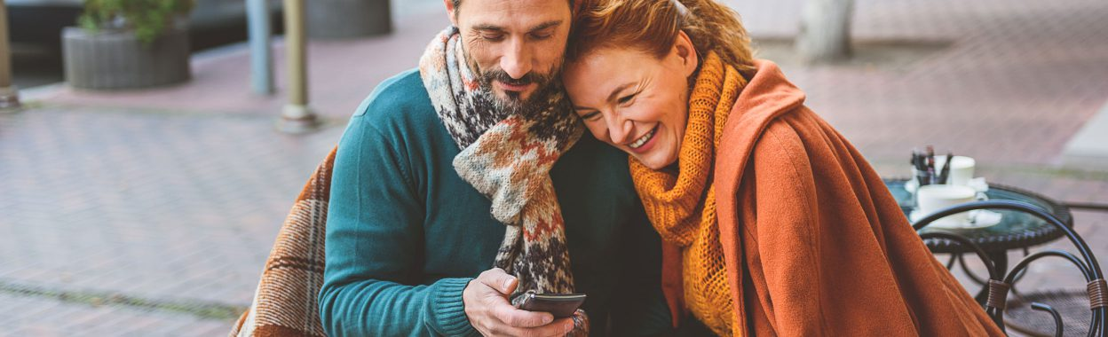 Couple-with-smartphone-and-blanket_2496x760-1248x380