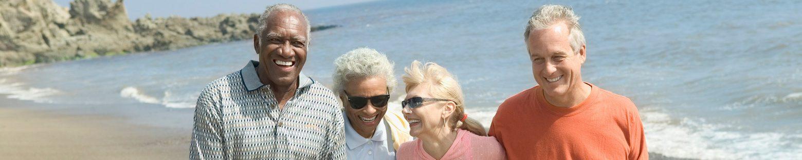 Friends-on-beach_2496x500-1560x313